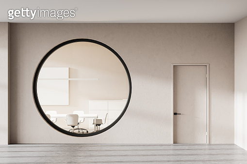 Beige meeting room with round window