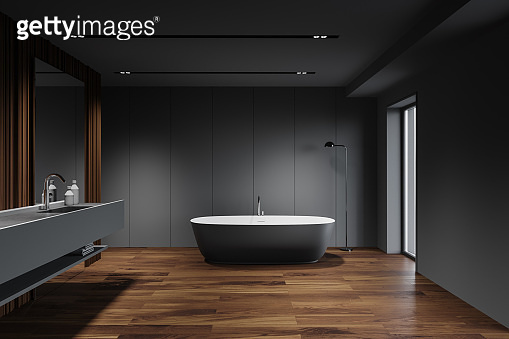 Grey and wooden bathroom, tub and sink