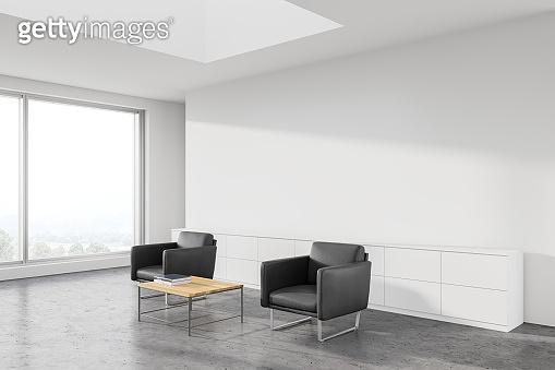 White office waiting room corner, grey armchairs