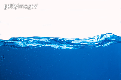 Water splash. Aqua flowing in waves and creating bubbles. Drops on the water surface feel fresh and clean. isolated on white background