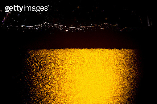 Texture of water drops on the bottle of beer,Macro beer surface