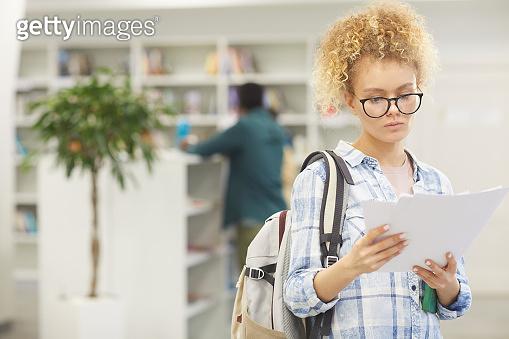 Teenager in School Library