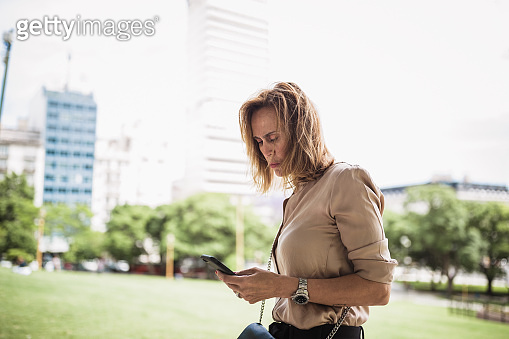 Businesswoman, rushing to the office, using phone