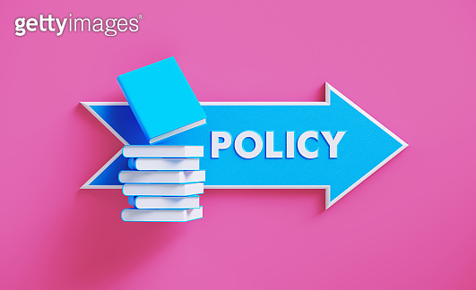 Book Stack Sitting over A Blue Arrow Shaped Directional Sign on Pink Background