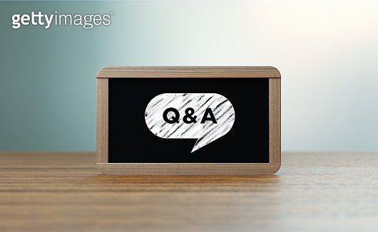 Wooden Framed Blackboard with Q and A Icon Sitting over Wooden Surface