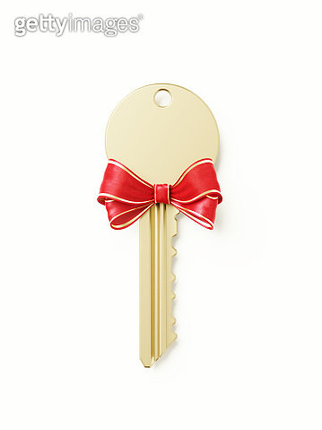 Bronze Key wit Red Bow on White Background