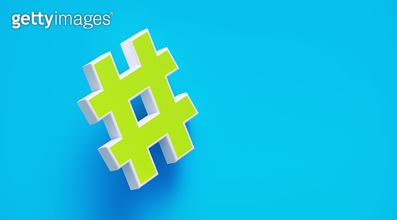 Hashtag Symbol In Front Of Blue Wall
