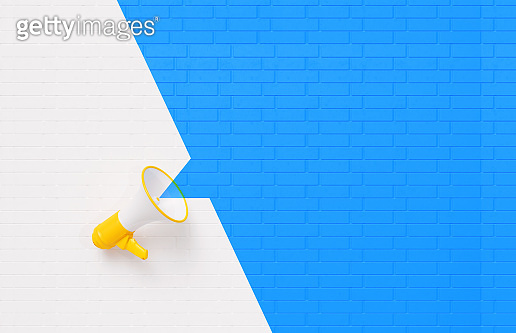 Yellow Megaphone on White and Blue Wall Background