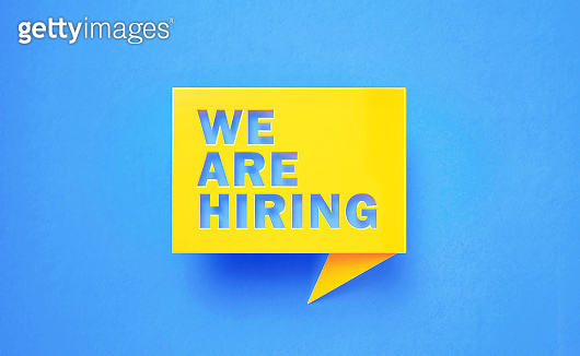 We Are Hiring Written Yellow Chat Bubble on Blue Background