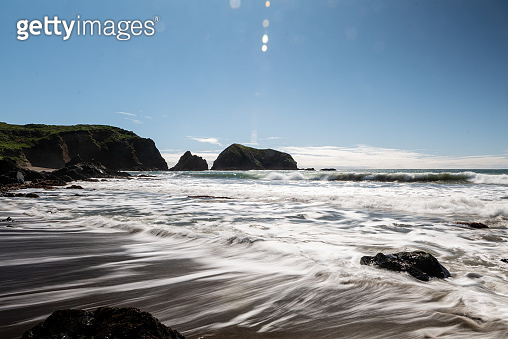 Long exposure of waves on Northern California coast on sunny day
