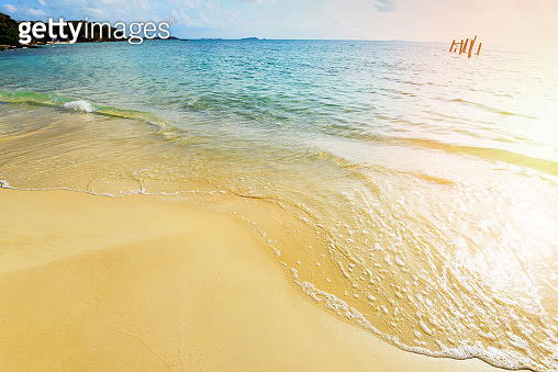 Sea waves on sand beach water and coast seascape - View of beautiful tropical landscape beach sea island with ocean blue sky and resort background in Thailand summer beach vacation