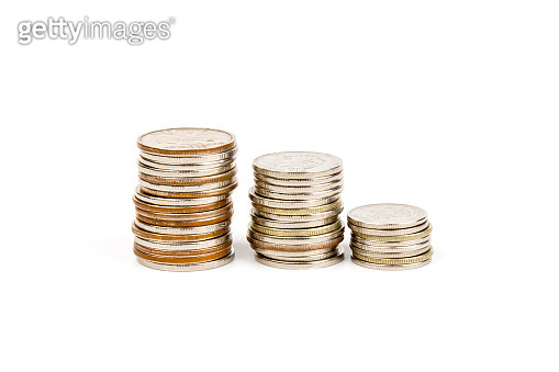The stack of coin on white background, concept of calculating expenses, incomes and expenses.