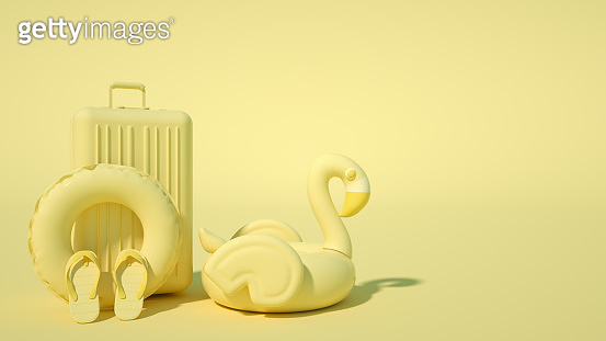 Inflatable flamingo and suitcase on yellow background, minimal summer and travel concept