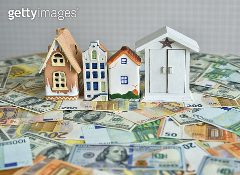 money and house model on the table. concept on the topic of construction and money