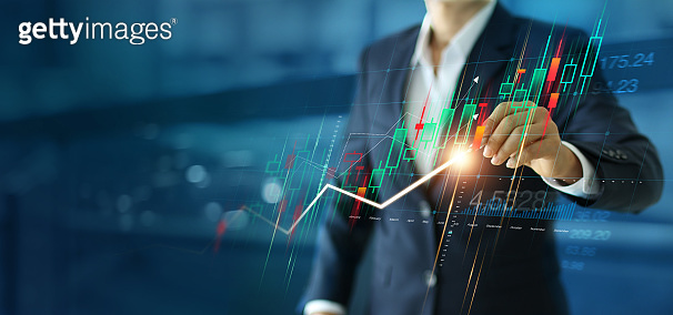 A businessman drawing business growth graphs, Analysis, strategy and planning, Marketing and Stock market, data exchange.