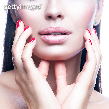Lips, partial beauty face of model woman, touching healthy skin