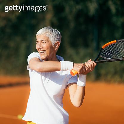 Active Lifestyle Seniors – Positive Mature Woman Playing Tennis Recreationally