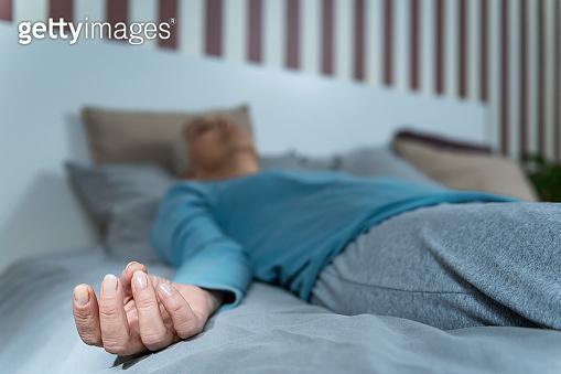 Sleep Meditation. Woman Lying in Bed, Meditating for Better Sleeping