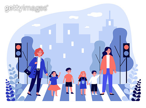 Two women crossing road with group of children