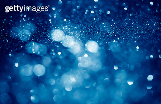 Glowing Particles, abstract blue bokeh background