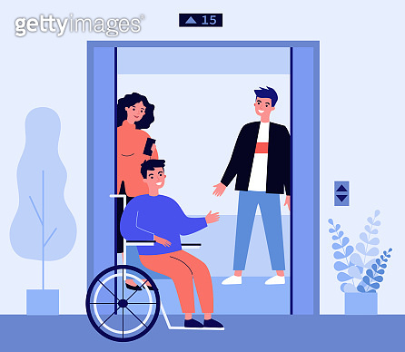 Disabled man getting into elevator cabin