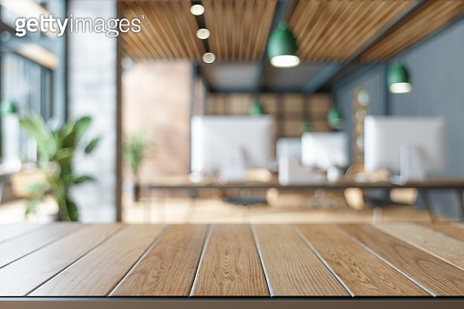 Wood Table On Blurred of Office Building.