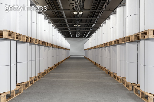Paper Rolls In A Row In The Warehouse