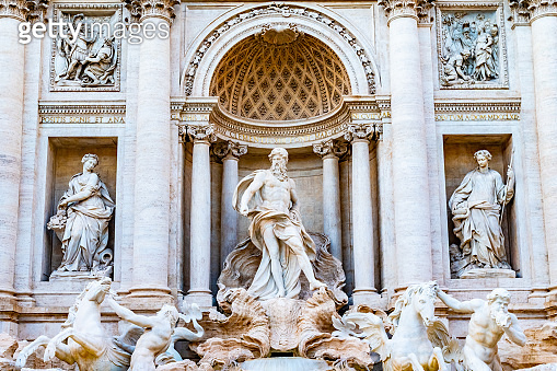 Trevi district, Rome, Italy. Sculptures on Palazzo Poli, and on Trevi Fountain.