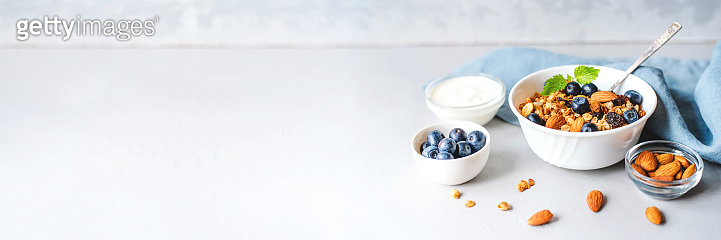 Baked granola with yogurt and blueberries.