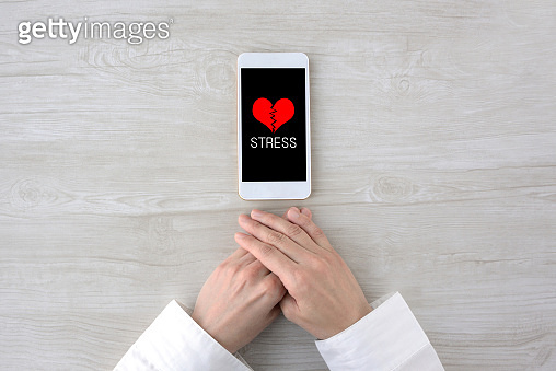 Person feeling stress from human relationships with smart phone