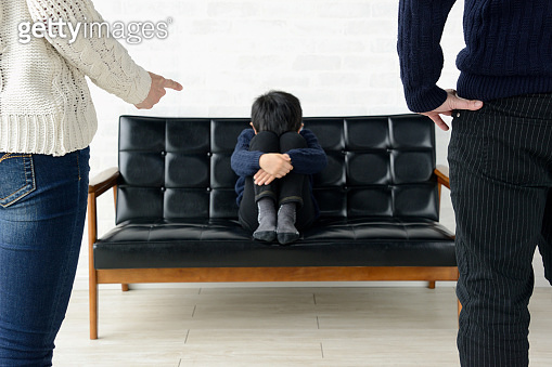 Parents scolding child in living room