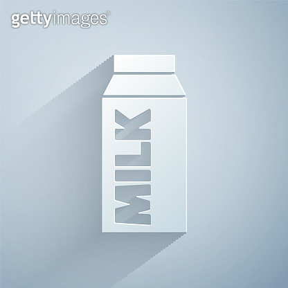 Paper cut Paper package for milk icon isolated on grey background. Milk packet sign. Paper art style. Vector