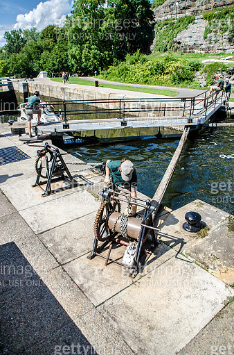 Men opening locks for a boat