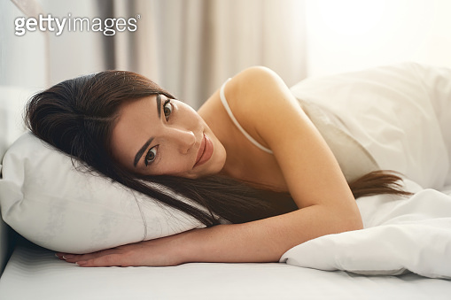 Tranquil Caucasian woman resting in her bedroom