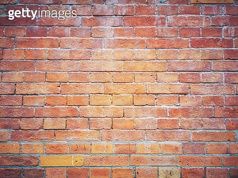 Brick wall background. Brown and red bricks, masonry texture of a building exterior