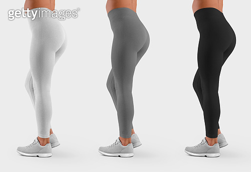 Mockup of white, gray, black leggings on a model, clothes for sports and fitness, side view for design presentation.