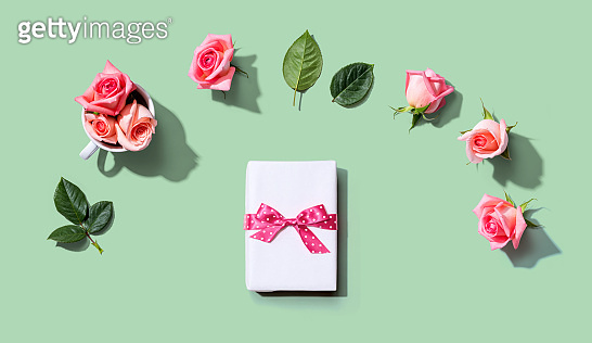Gift box with pink roses overhead view