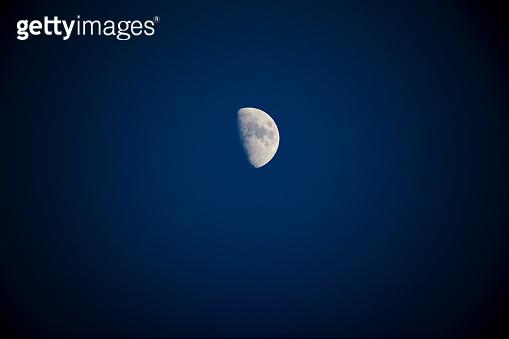 Half Moon photographed through a long focal telescope.