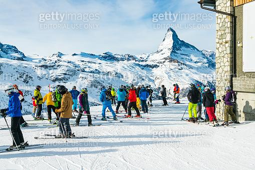 Skier looking at Matterhorn mountain at Zermatt ski resort, Switzerland