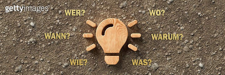 wooden lightbulb with the German words for WHEN, WHAT, WHERE, WHO, WHY and HOW - 3d illustration