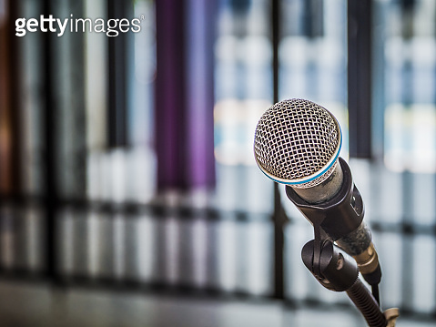 Close up of microphone on abstract blurred background for speech in seminar room or communication and speaking conference hall, Background concept.