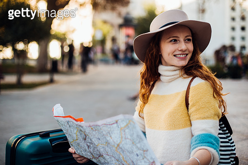 Beautiful girl on a journey exploring the city