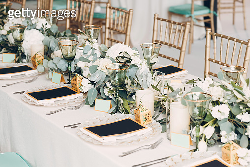 Wedding table flowers decor in white and green colors