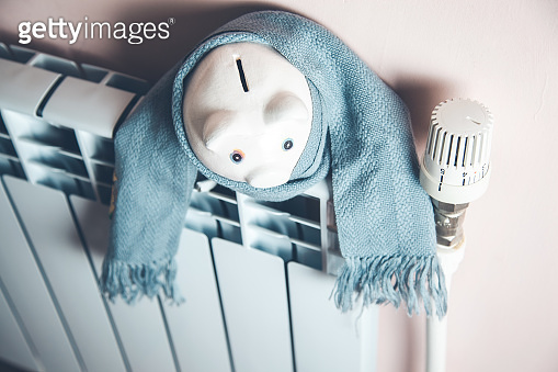 piggy bank with scarf on Heating System