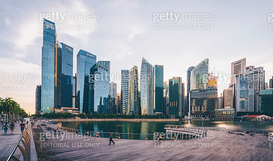People in front of the skyline of Singapore city