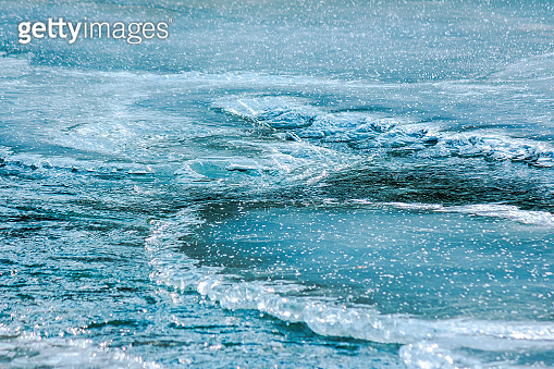 icy surface of frozen river