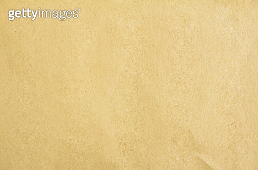 Brown tan cardboard paper with rough surface texture background. Copy space for text message.