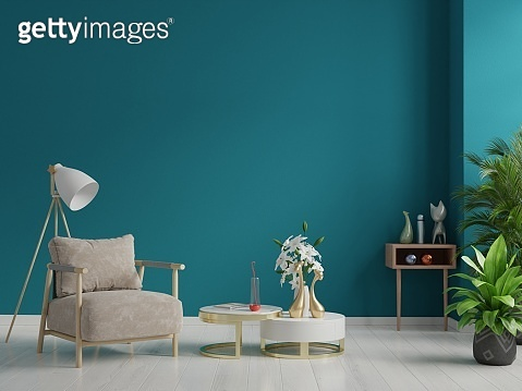 The interior has a armchair on empty dark green wall background.