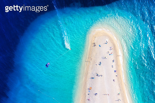 Croatia, Hvar island. Aerial view on the beach and windsurfer. Beach and sea from air. Famous place in Croatia. Summer seascape from drone. Travel - image