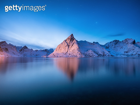 View on the mountains in the Hamnoy village, Lofoten Islands, Norway. Landscape in winter time during blue hour. Mountains and water. Travel - image